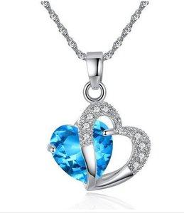 Kettng met hartje en blauw kristal